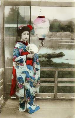 Geisha in 1900 in traditional women`s japan silk dress.