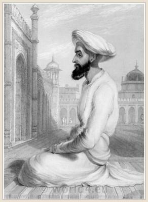 India Mughal costumes. Traditional India clothing. A Mohammedan praying.