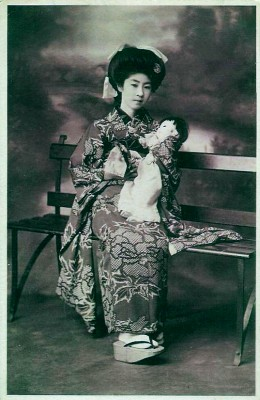 Traditional Japan national costume. Japanese women`s clothing. Geisha, Maiko in antique kimono.