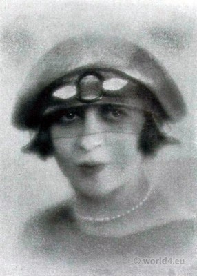 Cora Marson. Flapper Hat with hat with eyes veil. 1920s Fashion. Art deco costumes.