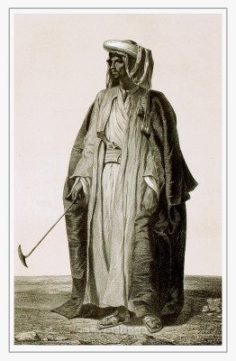 Traditional Arabian dress. Arab burnus costume. Bedouin Caftan and Turban.