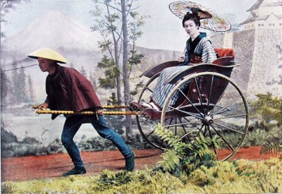 In the rickshaw. Carriage of old Japan. Traditional Japan geisha costumes.