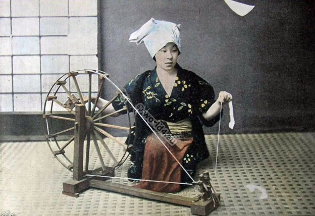 Young japanese woman spinning cotton. Traditional Japan kimono. Old japanese dress.