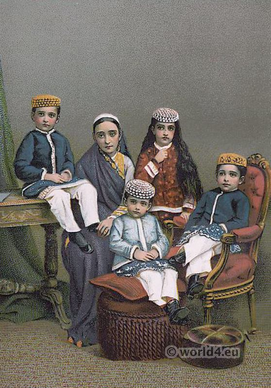 A Parsee mother with her children. Zoroastrianism in India. Traditional Parsee clothing. History of the Parsis.