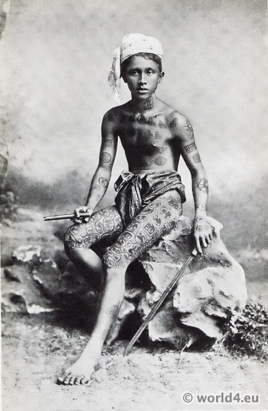 Boy from Burma with tattoo body art. Burmese costume
