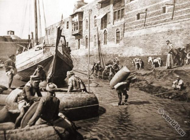Guffa, round basket boat. Baghdad Arab porters costumes, Tigris, Euphrates